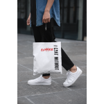 cropped-face-mockup-of-a-man-holding-a-tote-bag-in-the-street-29424 (1).png